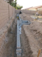 Concrete-filled retaining wall