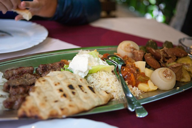 Cevapis, pita, rice, potatoes, onions stuffed with meat, meat patties, meat rolled in grape leaves, more meat, etc.